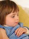 Girl Broken Arm Sling. A young girl with a broken arm in a sling. Close-up portrait, indoors royalty free stock photo