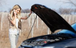 Girl with broken car Stock Photos