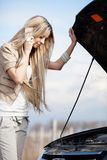 Girl with broken car Royalty Free Stock Images