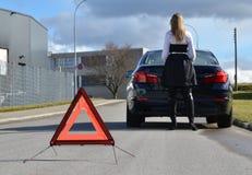 Girl at a broken car Stock Images