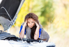 Girl with a broken car royalty free stock images