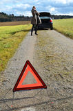 Girl, broken car and triangle. Girl, broken car and warning triangle Stock Photography