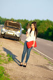 Girl with a broken car. Waiting for help Royalty Free Stock Photography