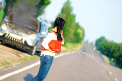 Girl with a broken car. Waiting for help Stock Photos
