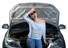Girl broken car white background Royalty Free Stock Image