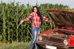 Girl with broken car Royalty Free Stock Photo