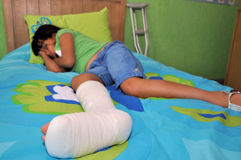 Girl with broken leg Royalty Free Stock Photo