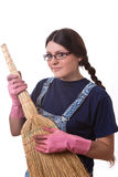 Girl with broom Stock Images
