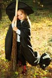 Girl with broom Royalty Free Stock Image