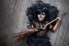 Girl with broom Stock Photography