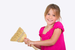 Girl with broom Royalty Free Stock Photo