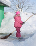 Girl with a broom. A girl with a broom outside stock image
