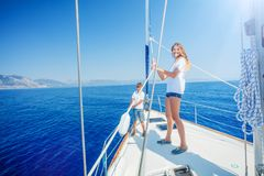 Girl with brother on board of sailing yacht on summer cruise. Girl with her brother on board of sailing yacht on summer cruise. Travel adventure, yachting with royalty free stock photos