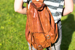 Girl with a brown backpack Royalty Free Stock Photos