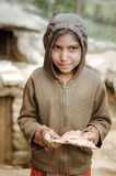 Girl in brown with cake in Nepal Royalty Free Stock Photo