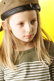 Girl in brown cap Royalty Free Stock Images