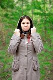 The girl in the brown cloak in the woods. royalty free stock photo