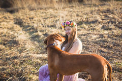 Girl and brown dog Royalty Free Stock Images