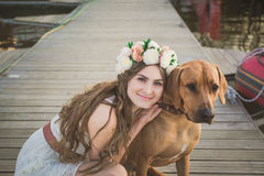 Girl and brown dog Royalty Free Stock Photo