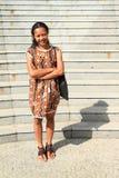 Girl in brown dress Stock Photos