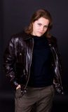 Girl in a brown leather jacket Royalty Free Stock Images