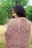 Girl in a brown shawl Royalty Free Stock Image