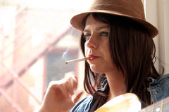 Girl in Brown Suede Hat Smoking Stock Photo