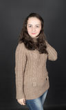 Girl in brown sweater Royalty Free Stock Photography