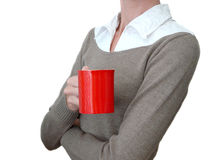 Girl in brown sweater with red coffee cup in hand. Girl in brown sweater with red cup in hand Stock Images