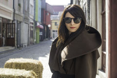Girl in brown wool jacket. On a street stock image