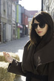 Girl in brown wool jacket. On a street stock photography