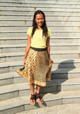 Girl in brown and yellow skirt Stock Images