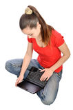 Girl browsing internet on laptop Royalty Free Stock Image