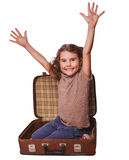 Girl brunette baby sitting in suitcase for travel isolated on wh Stock Photo
