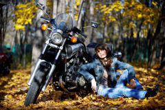 Girl brunette with a motorcycle Royalty Free Stock Images