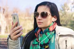 The girl the brunette in a scarf and solar points Stock Photo