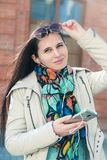 The girl the brunette in a scarf and solar points Royalty Free Stock Images