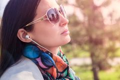 The girl the brunette in a scarf and solar points Royalty Free Stock Image