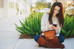Girl brunette on the street Stock Images
