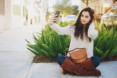 Girl brunette on the street Stock Photography