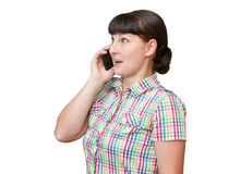 Girl brunette talking on a cellular phone Royalty Free Stock Photography