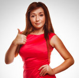 Girl brunette woman shows positive sign thumbs yes Stock Photos