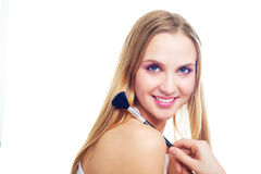 Girl with a brush Royalty Free Stock Photography