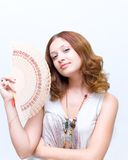 Girl brush away face by fan Royalty Free Stock Photography