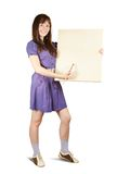 Girl with brush  and blank  canvas Stock Photo