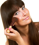 Girl with brush for blush Royalty Free Stock Image