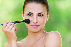 Girl with brush for makeup Royalty Free Stock Photos