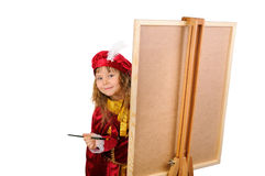 Girl with a brush near an easel Stock Photo