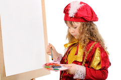 Girl with a brush and paints near an easel Royalty Free Stock Photography