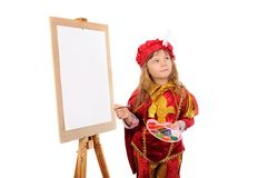 Girl with a brush and paints near an easel Stock Photos